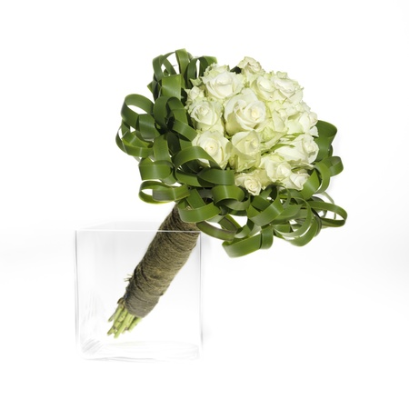 wedding bouquet with white roses and fresh green leaves Stock Photo
