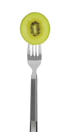 kiwi fruit on a fork, isolated on white