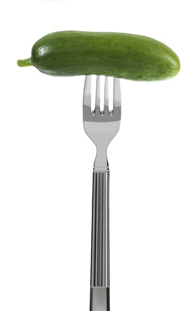 cucumber on a fork, isolated on white Stock Photo