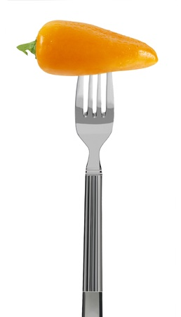 fresh yellow paprika on a fork, isolated on white Stock Photo