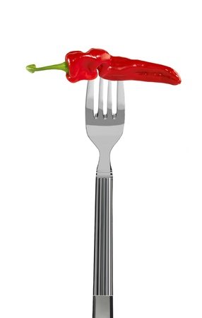 fresh red pepper on a fork, isolated on white