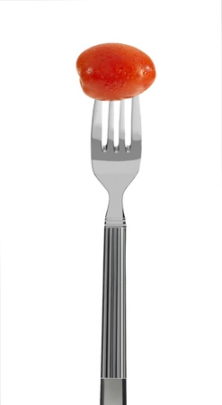 fresh mini tomato on a fork, isolated on white Stock Photo