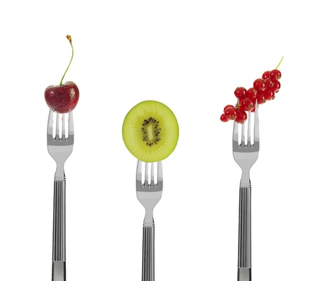 fresh fruit on forks, isolated on white