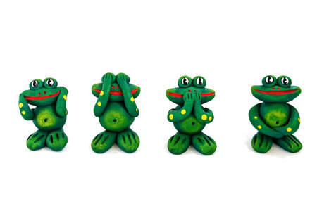 four frogs statues in funny position