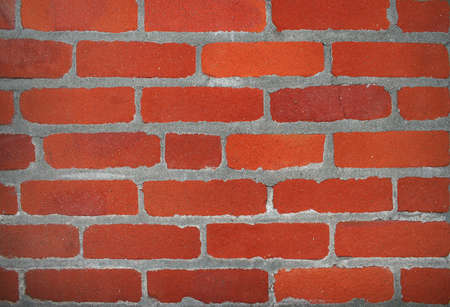 Red old brick wall as a texture