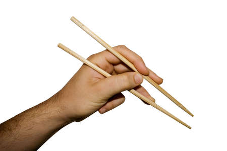 A hand using chopsticks isolated on white background Stock Photo