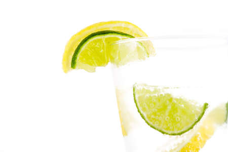 Beverage with lemon and lime isolated on white background