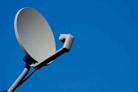 receiver: Satellite receiver dish on a blue sky Stock Photo