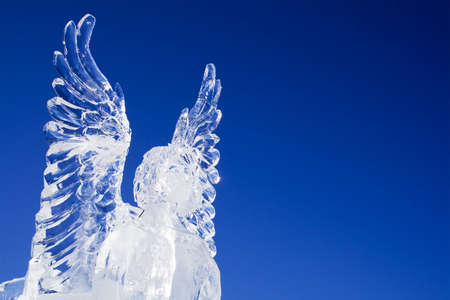 sculptures: Ice angel looking ahead on a beautiful blue sky