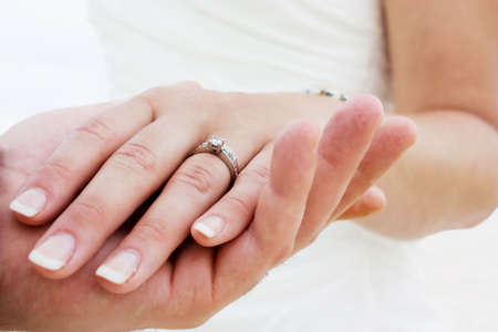 Couple holding hands with wedding rings (just married) Imagens