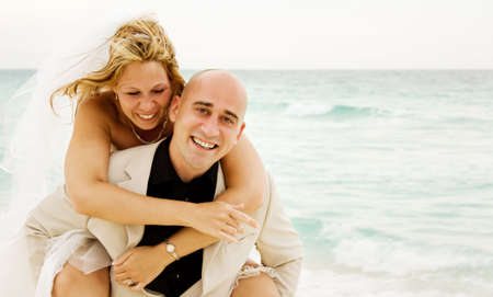 Beautiful couple just get married on the beach and having some fun Stok Fotoğraf