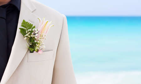 Grooms wedding suit with boutonniere made of flower and green leaves Stock Photo