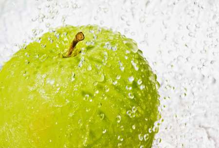 Green apple with drop of water isolated on white background Stock Photo