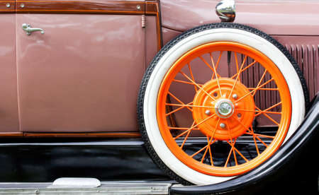 Old car with orange tire profile photo