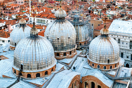 doomed: Panoramic aerial view of Venice cityscape and doomed roof (domes) of St. Mark Cathedral (Basilica) seen from St. Mark Campanile Bell Tower, Italy