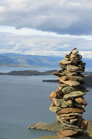 conglomeration: view from top of the mountain on the lake Baikal. Conglomeration of stones made by shaman.