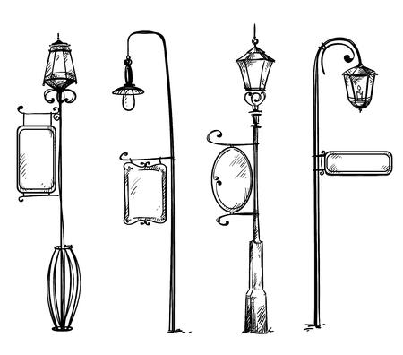 Lampy uliczne ze znakami informacyjnymi