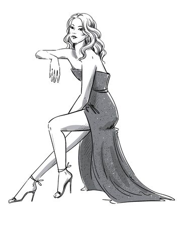 Fashion  of a young woman in an evening dress sitting