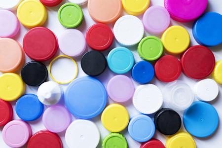 Plastic bottle caps on white background