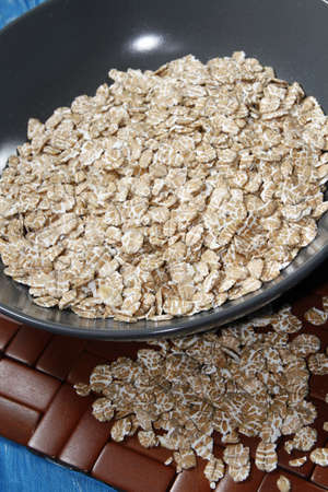 roughage: oat flakes in grey ceramic bowl