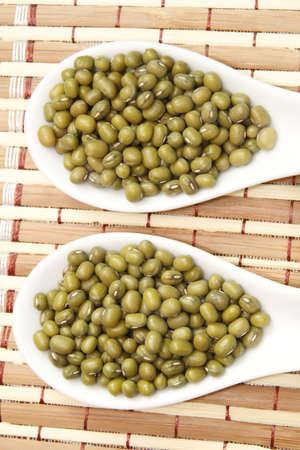 mung beans on white ceramic spoon Stock Photo - 23419293