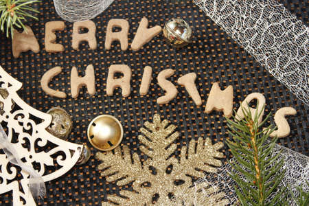 words merry christmas made from gingerbread with christmas decorations photo