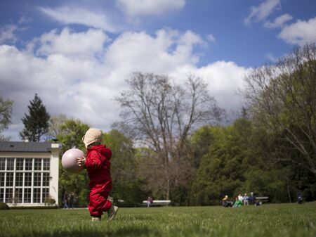 Baby playing with a ball in the park