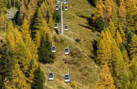 ropeway: Rope-way and larches in autumn on Mount Sarezza, Cuneaz  Ayas Valley, North Italy  Stock Photo