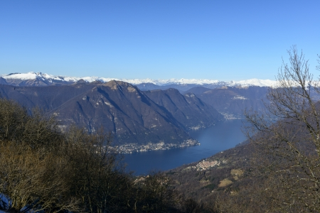 View of the Como lake with Alps in background, Mount Bolettone  North Italy  photo