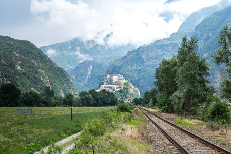 bard: Railway tracks with Fort Bard in background, Aosta Valley  Italy