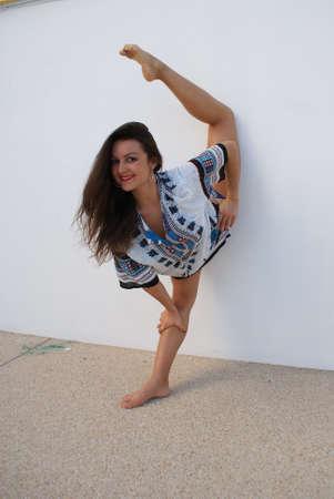 Beautiful young brunette woman make gimnastic Фото со стока