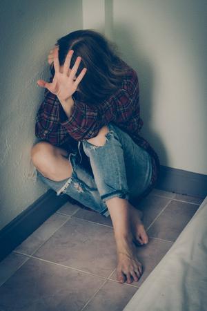 Woman abuse victim. Domestic violence, harassment, depression, drug addiction, human trafficking. PTSD post-traumatic stress