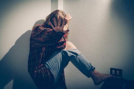 Woman abuse victim. Domestic violence, harassment, depression, drug addiction, human trafficking. Stock Photo