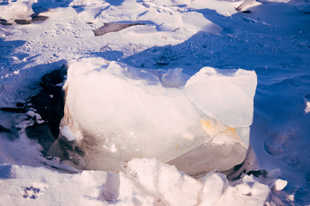 Blocks of ice gleaming in the sun. Arctic winter background. ice texture