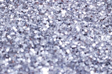 Silver glitter texture. Festive sparkling sequins background. Wpaper for Valentine, New Year or Christmas Holidays