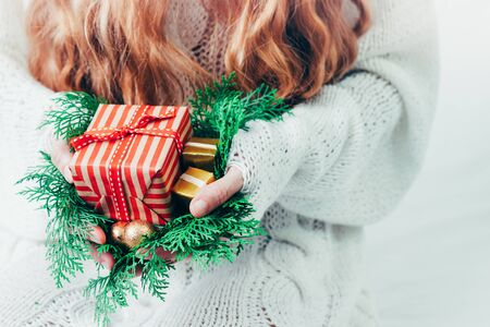 Christmas or new year gift box in womans hands.