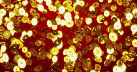 Golden Chinese coins. Red New Year background.
