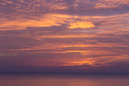 cirrus clouds at sunset over the sea