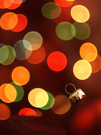 Christmas decoration in the form of red baubles and blurred Christmas lights in the background. photo