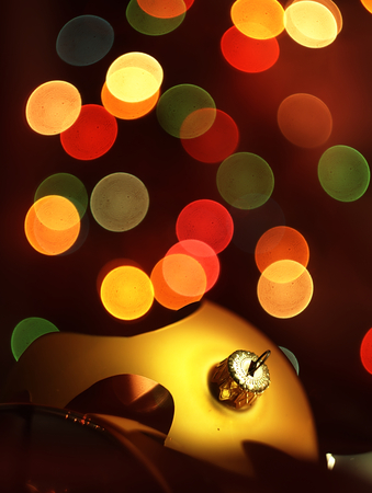 Christmas decoration in the form of broken glass balls and blurred Christmas lights in the background. photo