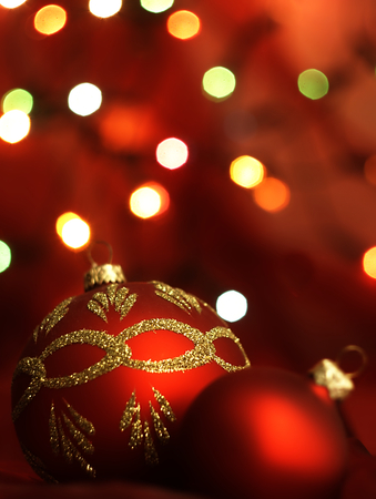 Christmas decoration in the form of golden baubles and blurred Christmas lights in the background. photo