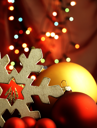 Christmas decoration in the form of a wooden snowflake and Christmas lights blurred in the background. photo