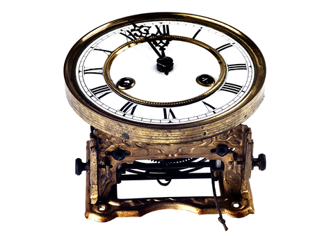 past midnight: Mechanism of old clock. Clock face and hands showing five minutes to midnight.