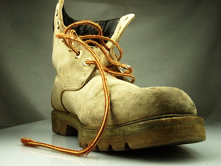 muddy clothes: The old, heavy and dirty shoe. Alone and without the other shoe.