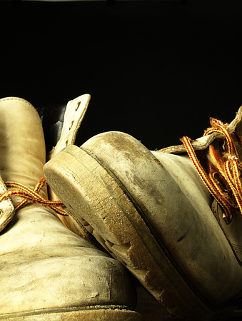 muddy clothes: Two old heavy, worn shoes, seen from the perspective of frogs. Stock Photo