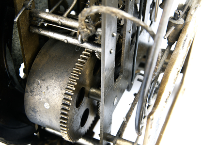 sprockets: Old clock seen from the side of its mechanism together with the sprockets.