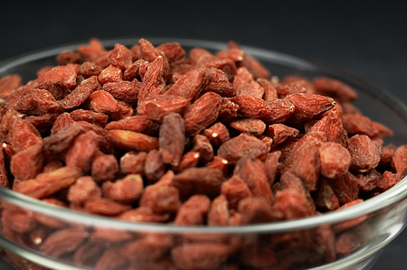 superfruit: Goji berries in a bowl on the table.