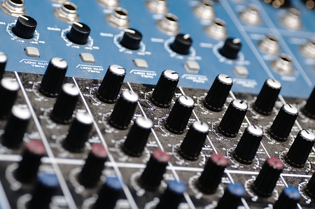 jacks: Sound mixer in the studio. Colored switches, jacks and knobs.