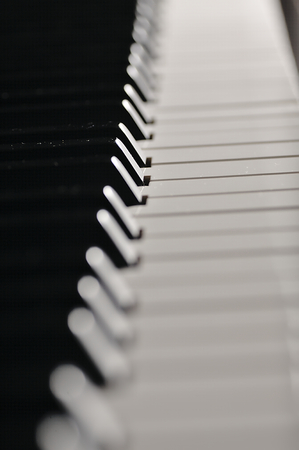 pianoforte: Electronic piano prepared for the concert. White and black keys ready to play sound.