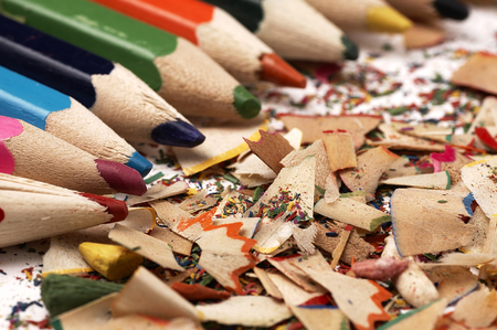 individualism: Colorful wooden pencils. Artistic mess on the table.